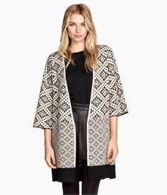 Long black & white jacquard-knit cardigan with 3/4-length sleeves, side slits, and geometric effect. | Warm in H&M