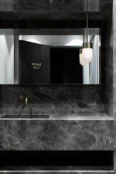 Wash basin in natural stone - Maison du Danemark in Paris by GamFratesi
