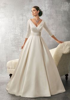 Wedding dress idea. White Dupion Silk Fabric. Use covered buttons rather than rhinestone. Full length sleeves.