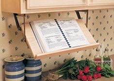 Small Kitchen Ideas with Marvelous Retractable Book Stand or Cookbook Holder to Make Your Work in The Kitchen Easier: Where To Find Wooden Retractable Book Stand Or Holder Under The Wall Cabinets And The Easy Swing Down Shelf Can Be Mounted And Finished To Match Your Cabinetry ~ luciomorini.com Bookshelves Inspiration