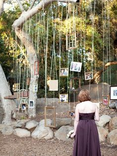 I don't like how they did this one, but I like the idea of hanging frames for outdoor reception