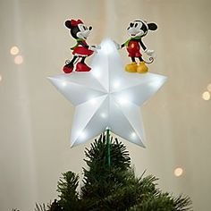 Let our stars shine brightly with this lighted Mickey and Minnie holiday tree topper. Disney's timeless twosome sit at the center of a sculptured star, a celestial celebration to top off your Christmas tree creation!