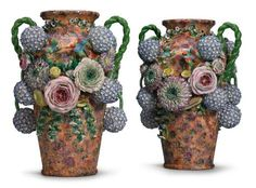 A PAIR OF JACOB PETIT PORCELAIN FLOWER-ENCRUSTED VASESMID-19