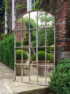 Arch window mirror for display in the home and garden area ..