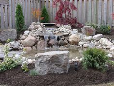 One tier waterfall to natural stone pond.