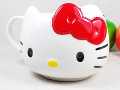 Ebay - Hello Kitty White Ceramic Coffee Tea Mug Cup RED Bowknot £9.24 (bow colouring comes off eventually)