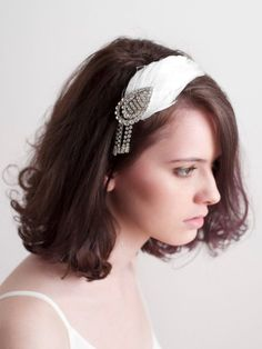Wedding Hairstyles with a vintage feather headband