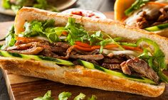 Photo about Vietnamese Pork Banh Mi Sandwich with Cilantro and Daikon. Image of food, vietnamese, marinated - 43064171 Sandwich Recipes, Pork Recipes, Asian Recipes, Cooking Recipes, Healthy Recipes, Ethnic Recipes, Sandwich Ideas, Vietnamese Sandwich, Steak Sandwiches