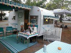 Soooo cute aqua & white vintage camper luv the folding fence blocking hitch