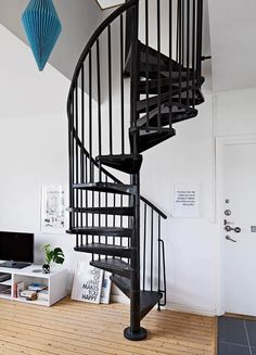 Spiral staircase in Ingeniously Designed Two Floor Apartment With Decadent Accents How To Make Stairs, Black Stairs, Off White Walls, Estate Homes, Second Floor, Flooring, Interior Design, Loft, Spiral Staircases