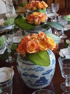 Pretty Oriental jars with gorgeous orange roses!