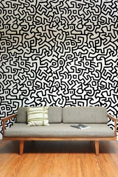 Line Drawings on the wall instead of hanging a painting... compliments the minimalist feel of the furniture
