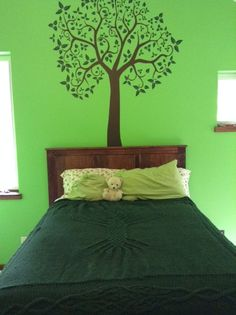 The tree of life decal on wall matches our new blanket on the bed!