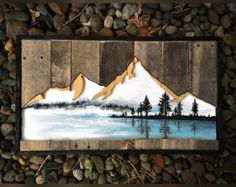 This is a part of my smaller collection measuring at 10x14. This piece is made of reclaimed wood with a cut out grizzle bear. Inside is painted a beautiful lake and mountains scene with acrylic paint.