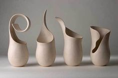 Sculptural vases. I wish I had a pottery wheel so I could attempt to make these
