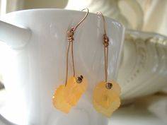 Tangerine earrings for Spring/Summer 2015,  by CalicoRoseStudio on Etsy, £9.50.  Lucite leaves on hand forged antiqued copper.