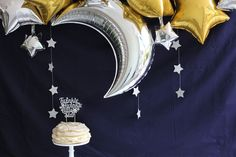 silver gold and navy blue moon and stars party sweet table with twinkle twinkle little star cake topper