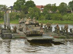 U.S. Army Soldiers, assigned to 1st Armored Brigade