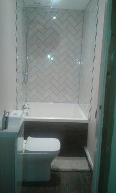 Tiny bathroom, deep soaking bath, omnitub, topps tiles wynter hues tile
