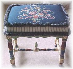 Painted and needlepoint upholstered stool.