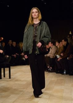 Khaki green oversize bomber jacket, worn with The Small Belt Bag and luggage-stitch detail wide-leg trousers