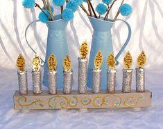 Love this DIY menorah for Hanukkah time!