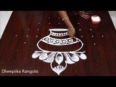 Rangoli is an artistic creation with rice flour that is made outside the front entrance of the house It is usually done by the women folk of the house early . Best Rangoli Design, Rangoli Designs Latest, Rangoli Designs Flower, Rangoli Border Designs, Small Rangoli Design, Rangoli Patterns, Rangoli Designs Images, Rangoli Ideas, Rangoli Designs With Dots
