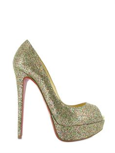 Christian Louboutin way too spendy heels, but I can click them to go home.