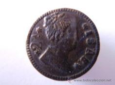 Botón monarquico, con el busto de Isabel II durante su juventud 1833-48. con leyenda corriente: 2ª/