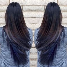 Oil slick blue hair extensions on dark brown hair