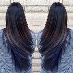 Oil slick blue hair extensions on dark brown hair