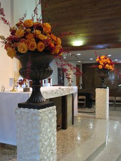 Ceremony flowers on pillars covered with fabric of your choice