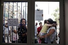 Explaining the Greek Crisis:  People wait outside Medicins du Monde, a free clinic, in Athens, Greece, September 3, 2012. (Photo: Adam Ferguson / The New York Times)