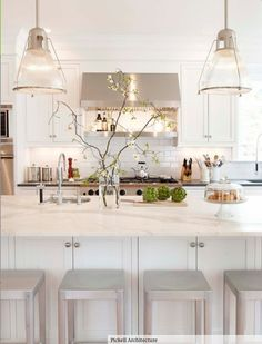 Great way to add height: long, scraggly branches #kitchen #nature #white #trees