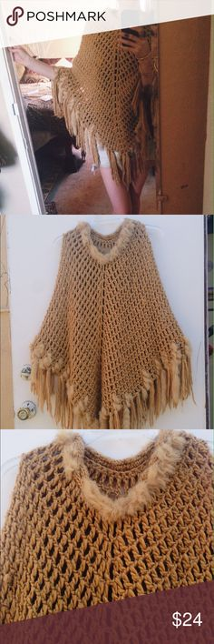 Macchiato Moon Poncho Kenneth Cole New York Collection Poncho. This stylish and cozy Poncho is great for lounging by a fire or night time vibing at a music festival. Super soft knit style in a gorgeous Carmel color trimmed and fringed with real rabbit fur. One size fits all, but beware she runs a little small. Flaws: Missing some fur trim around the neck line but not too noticeable. Dry clean only. Kenneth Cole Sweaters Shrugs & Ponchos