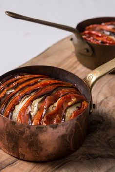 A twist on a traditional stuffed aubergine recipe, Andrew Mackenzie's vegan recipe makes a beautiful vegetable side or main, with layers of baked tomatoes and aubergines over a fragrant onion base.