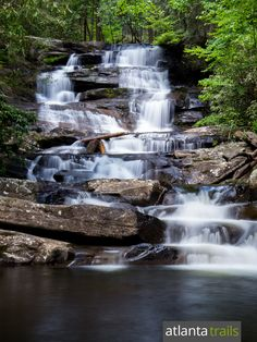 Hike the Emery Creek Trail in North Georgia through 20 creek crossings to a pair of stunning waterfalls in a lush, green forest