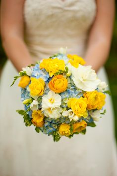 Yellow, baby blue wedding bouquet. Flowers.  Photo by Hans and Nicole Photography, www.hansandnicole.com