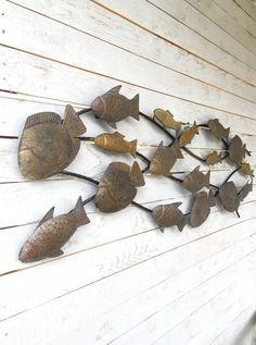 Large School Of Fish nautical metal wall art will provide a touch of color to any nautical room decor theme. Each metal accent wall hanging has an