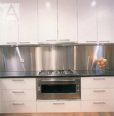 Custom cut your stainless steel splashback to any size and have delivered Melbourne wide. Stainless Steel Splashback, Stainless Steel Countertops, Stainless Backsplash, Kitchen Stove, Glass Kitchen, Stainless Steel Kitchen, New Kitchen, Kitchen Counters, Kitchen Room Design