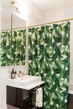 An inventive way to add plants into a windowless bathroom... (Sarah's Small & Stylish Brooklyn Apartment)