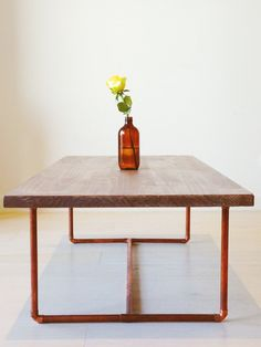 Lightly stained and lightly varnished pine table top to provide a degree of protection without giving it an overly glossy look. A sturdy copper                                                                                                                                                      More
