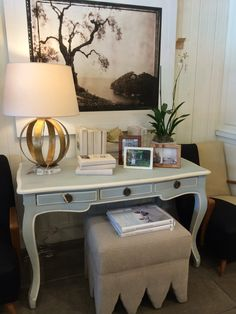 Mecox #Chicago #desk and #ottoman vignette with monochromatic #art and #gold based #lamp #interiordesign #MecoxGardens #furniture #shopping #home #decor #design #room #designidea #vintage #antiques #garden