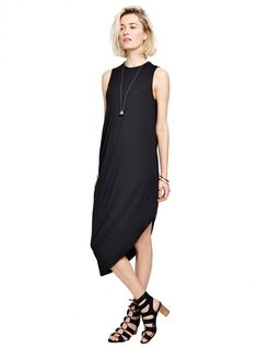 The Highline Dress | We love this sleek and modern maternity dress from Hatch. Solid color, draping details, and a unique cut for an expecting mother with classy taste.