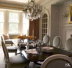 Classic Dining Room:  updated light chairs with traditional dark table Suzanne Kasler