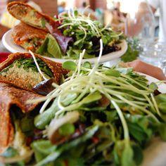 Raw vegan Mediterranean wrap with live falafels at vegan restaurant Cafe Gratitude in Venice, California.