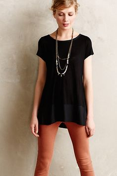 Drifting Tunic - anthropologie.com. Brick/dark red pants, black shirt, long necklace.