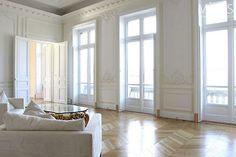 herringbone wood floors + floor to ceiling windows