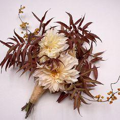 Arrangement of dahlias, bittersweet, and gum tree leaves. #weddings  Bouquet by Ariel Dearie Flowers