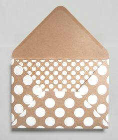 White poke a dots on brown bag paper is simple and expensive to print but how fun and fresh it looks.